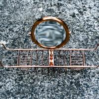 Convex vanity mirror on copper nickel or brass bath tidy